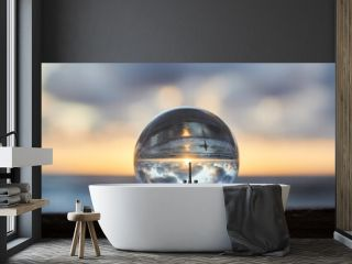 Magic sphere. Fortune teller, mind power concept. Crystal Ball reflecting water and sky.