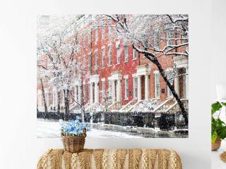 Snowy winter street scene with historic buildings along Washington Square Park in Manhattan, New York City