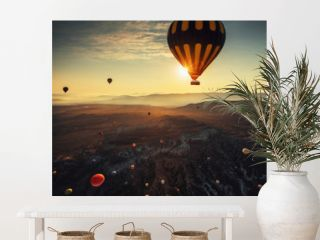 Hot air balloons flying on sunrise over the valley at Cappadocia. Turkey