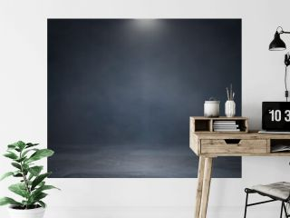 Empty dark abstract cement wall and studio room with smoke float up interior texture for display products wall background.