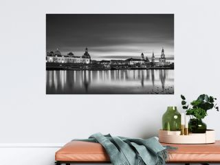 Dresden cityscape panorama in black and white. Fine art long exposure night picture of famous city in Europe with city lights and beautiful water reflections in Elbe river. Perfect image for wall