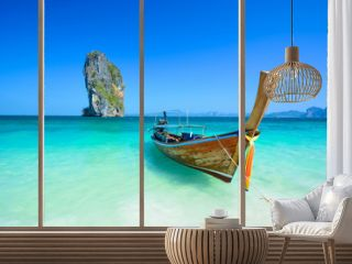 Cliff and boat in the amazing beach in tropical island in Krabi, Phuket, Thailand