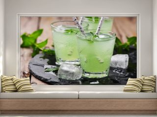 Green cocktail witn rum and mint