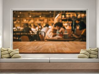 Wood table top with blur of people in coffee shop or (cafe,restaurant )background