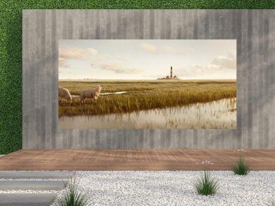 Wiesenlandschaft mit Schafen und Leuchtturm an der Nordsee