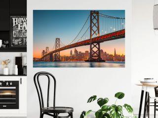San Francisco skyline with Oakland Bay Bridge at sunset, California, USA
