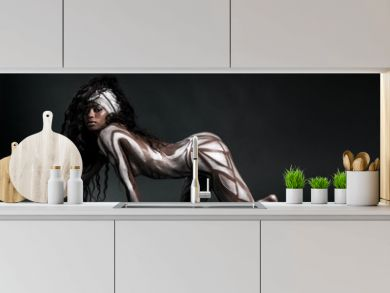 Sexy african model body painted with polygons