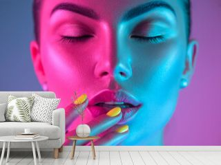 High Fashion model girl in colorful bright UV lights posing in studio, portrait of beautiful woman with trendy make-up and manicure. Art design, colorful make up. Over colourful purple background
