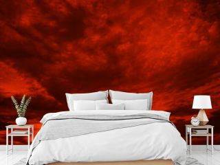 Abstract dark red background. Dramatic red sky. Red sunset with clouds. Fantastic sunset background with copy space for design. Halloween, armageddon, apocalypse, end of the world concept.