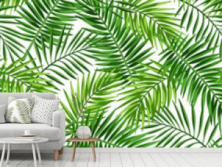 Vector tropical seamless pattern with green palm leaves on a white background.