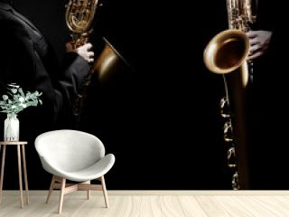 Jazz saxophone players. Saxophonist hands playing baritone sax