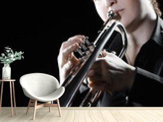 Trumpet player. Woman playing jazz trumpet
