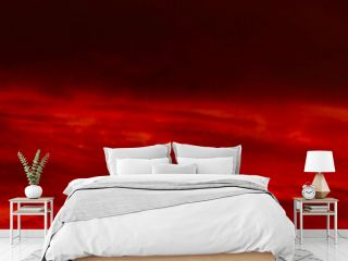 Red orange sunset background. Dramatic sky with clouds. Abstract red background with copy space for design. Wide banner. Panorama.