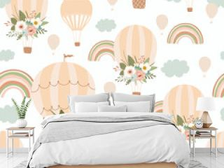 Kids seamless pattern with rainbow, air balloon and flower in pastel colors. Cute texture for kids room design, Wallpaper, textiles, wrapping paper, apparel. Vector illustration