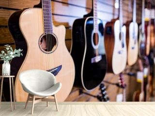 many guitars in a music store at the display window