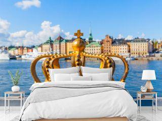 Golden crown on Skeppsholm bridge in Stockholm