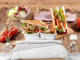sandwich club with ham,  cheese and vegetables