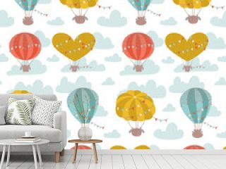 Cartoon flat seamless pattern with hot air balloons, flags and clouds. Cute vector background for kids.