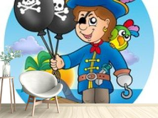 Pirate boy with balloons on beach