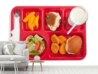 School lunch tray with food on it on a white backgrounf