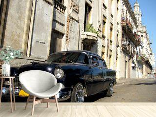 Black old car in the street