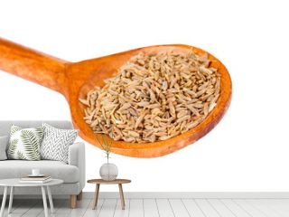 spice cumin in wooden spoon isolated on white