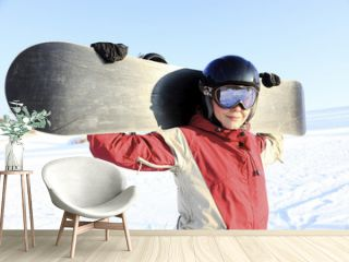 Female snowboarder on the snowhill.