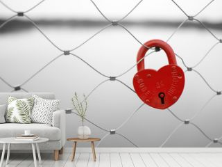 Love padlock on a bridge fence. Russian proverb on it.