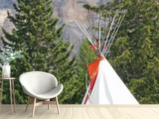 Indian teepee amidst the mountain meadow