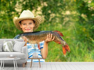 Boy holds big fish