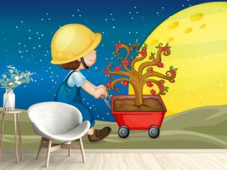 a boy and trolley with plant