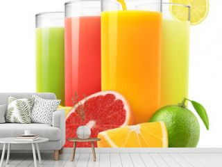 Isolated drinks. Glasses of fresh citrus juices (orange, grapefruit, lemon, lime) and cut fruits isolated on white background