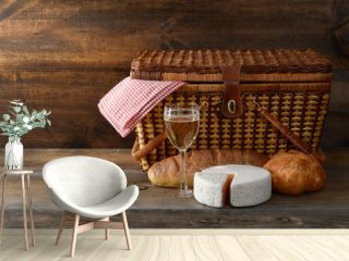 old picnic basket with wine and cheese