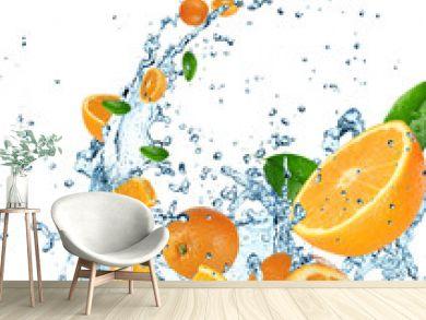 Fresh oranges in water splash on white background.