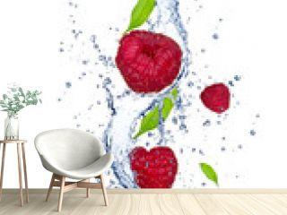 Fresh raspberries falling in water splash