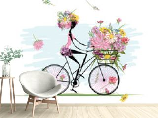 Girl with floral bouquet in basket cycling