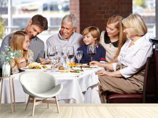 Happy family eating in restaurant