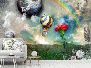 Hot air balloon in flight with rainbow
