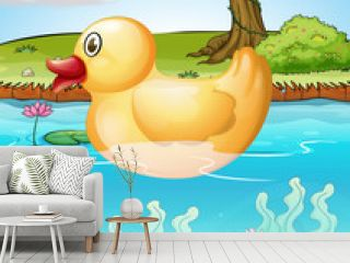 The yellow toy duck in the pond