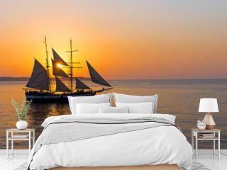 Romantic sunset with sailing ship