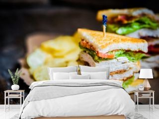 Club sandwich on rustic wooden background