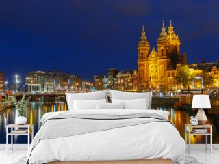 Night city view of Amsterdam canal and Basilica of Saint Nichola