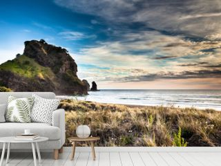 Beatiful sunset on Piha beach, New Zealand