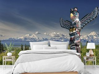 Mountain landscape with wooden totem pole