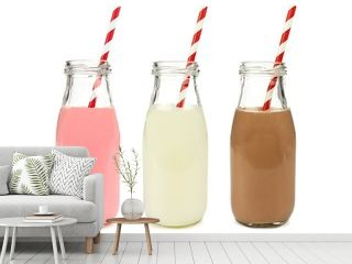 Strawberry regular and chocolate milk in bottles isolated