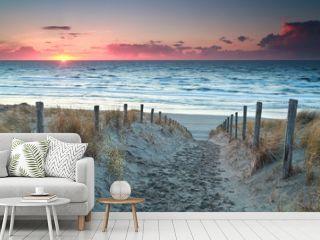 sand path to North sea beach before sunset