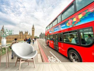 London. Double Decker bus speeding up on Westminster Bridge