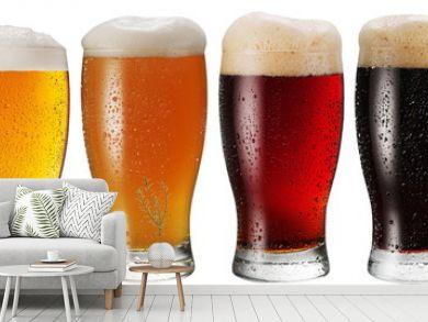Glasses of beer on white background.