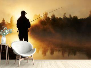 fisher fishing on foggy sunrise