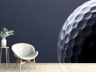 Stylish golf ball isolated on empty dark blue background.